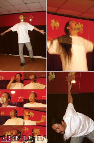 """""""Vị giác – Tàu Thần Chaua VI"""", 2005, Thành Đô: Đứng một chân, liếm chữ Thần Châu viết bằng mù tạt trên kính. Mù tạt làm chảy nước. Cuối cùng không giữ được thăng bằng nữa, ngã lăn ra đất"""
